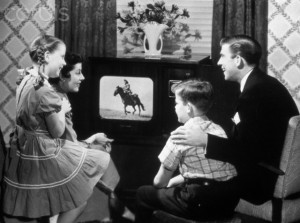 01 Jan 1950 --- 1950s family of four watching black and white television program of a cowboy riding a horse --- Image by © Ewing Galloway/ClassicStock/Corbis